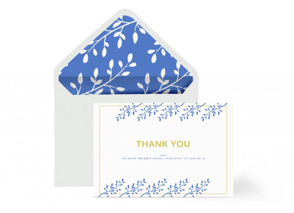 An envelope and a thank you card in blue and white, both elements have matching leaf drawings